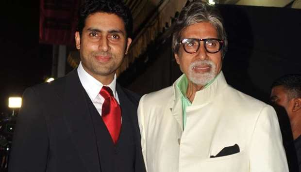 Bollywood actors Amitabh Bachchan (R) and his son Abhishek Bachchan pose during the inauguration of