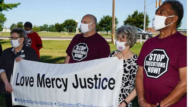 Individuals who oppose the death penalty gather outside the Federal Correctional Complex, Terre Haut