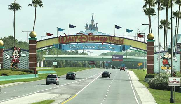 ALL ROADS LEAD TO DISNEY: Guests drive toward the entrance of Walt Disney World's Magic Kingdom in O