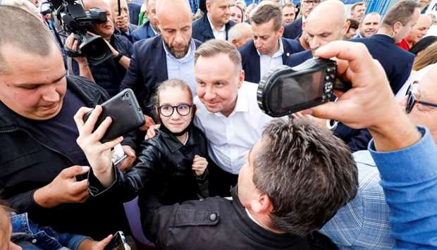 Polish President Andrzej Duda attends a meeting with local residents following his victory in a pres