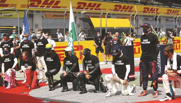 Mercedes' Lewis Hamilton (fourth from left) said that a number of drivers wanted to stop the pre-rac