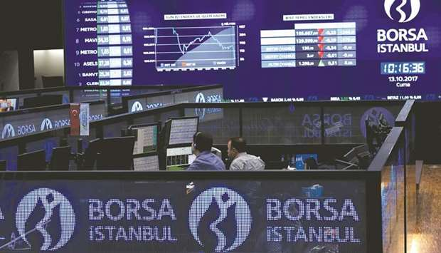 Traders work at their desks on the floor of the Borsa Istanbul in Istanbul (file). Turkey's market r