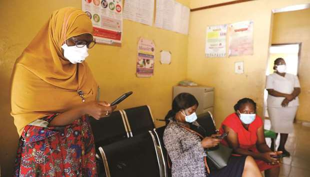 A member of the contact-tracing team checks her phone at a primary healthcare centre in Lagos.