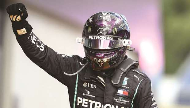 Mercedes' British driver Lewis Hamilton celebrates winning the Formula One Styrian Grand Prix race o