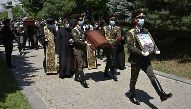 Armenian servicemen carry the coffin of Major Garush Hambardzumyan, who was killed during armed clas