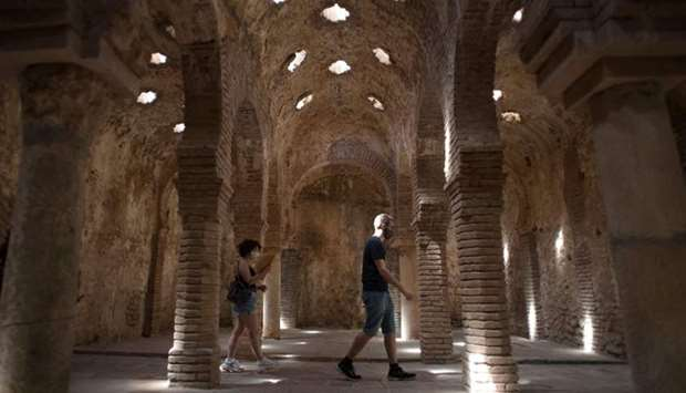 """Tourists wearing face masks visit the """"Hammam"""" (Turkish baths) in Ronda on July 15, 2020. More than"""
