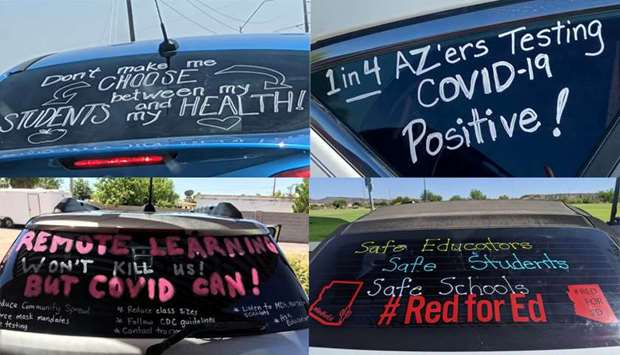 Slogans seen on cars in 'a motor march' protest of teachers who took it to their vehicles to demand
