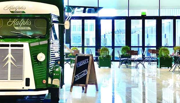 Ralph's Coffee truck, a hunter green 1965 Citroen, will first be parked inside the atrium lobby of M