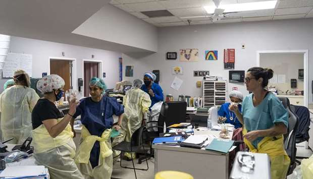 Medical staff gather in the Covid-19 intensive care unit at the United Memorial Medical Center, in H