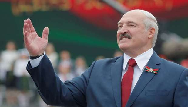 Belarusian President Alexander Lukashenko gestures as he takes part in the celebrations of Independe