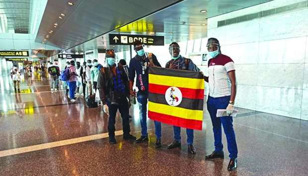 The second batch of Ugandans at Hamad International Airport before boarding the flight