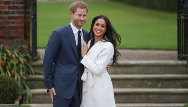 In this file photo taken on November 27, 2017 Britain's Prince Harry and his fiancée US actress Megh