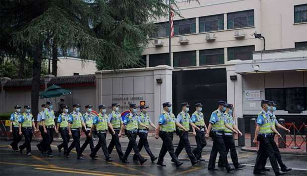 Policemen march past the US consulate in Chengdu, in Sichuan province