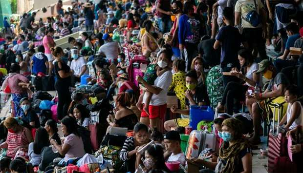 Filipinos stranded due to the coronavirus disease (COVID-19) restrictions are crammed inside a baseb
