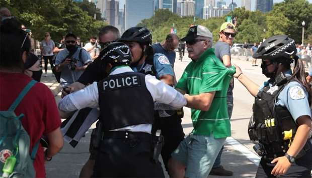 Police separate a pro-police demonstrator from counter-demonstrators during a Blue Lives Matter prot