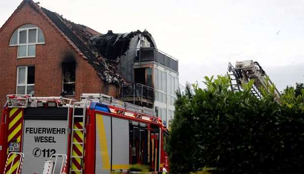 General view of the scene where an ultra-light aircraft has crashed into a residential building in W