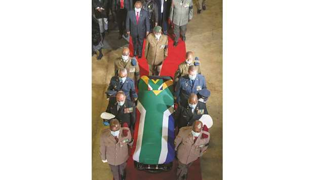 The flag-draped coffin