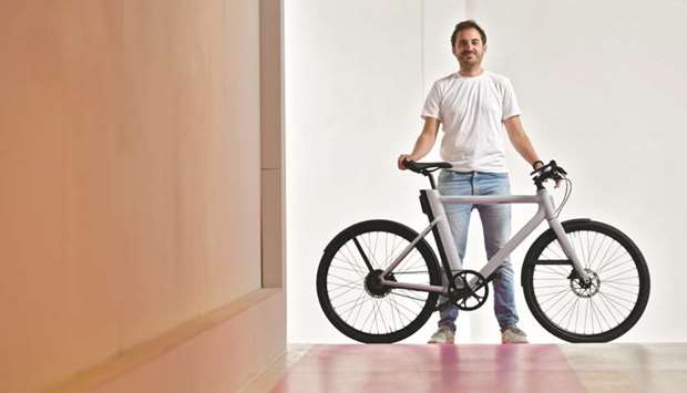 Founder and CEO of Cowboy Adrien Roose, a Belgian designer and manufacturer of electric bikes, poses