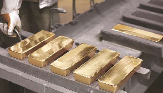Freshly cast gold ingot bars sit in the foundry at a non-ferrous metals plant in Krasnoyarsk, Russia