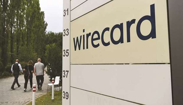 Visitors pass a sign at the entrance to the Wirecard headquarters in Munich. Pine Labs, the Indian p