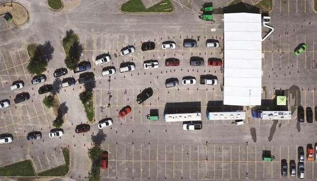 An aerial view from a drone shows people waiting in line at the drive-through Covid-19 testing centr