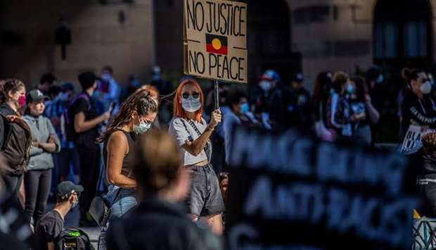 Protesters participate in a Black Lives Matter (BLM) rally, calling for an end to police brutality a
