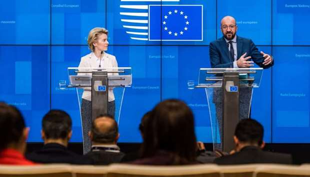Charles Michel, (right), speaks while Ursula von der Leyen,