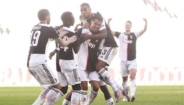 Juventus' Cristiano Ronaldo (centre) celebrates with  teammates after scoring against Torino in the