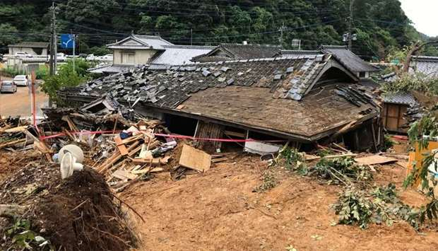 A general view shows a collapsed house following a landslide caused by torrential rain in Ashikita,