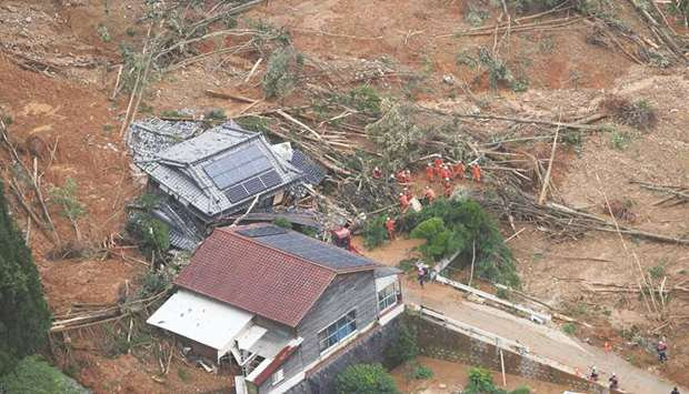 A house is washed away after a landslide due to heavy rain in Ashikita, Kumamoto prefecture, yesterd