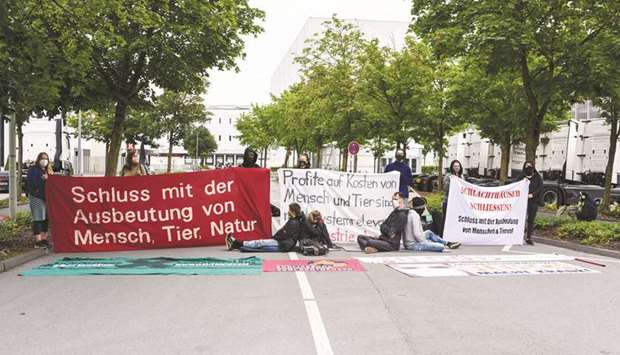 Activists protest outside the Tonnies slaughterhouse in Rheda-Wiedenbrueck, Germany.