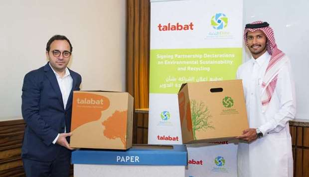 Talabat and Elite Paper Recycling officials mark the partnership.