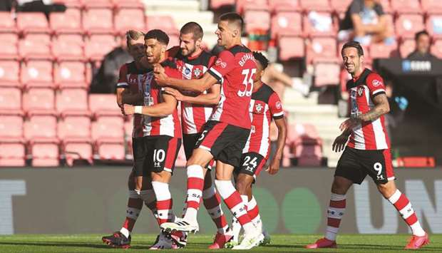 Southampton's Che Adams (second left) celebrates with teammates after scoring against Manchester Cit