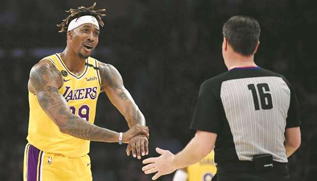 Dwight Howard (left) of the Los Angeles Lakers argues his foul call with referee David Guthrie durin