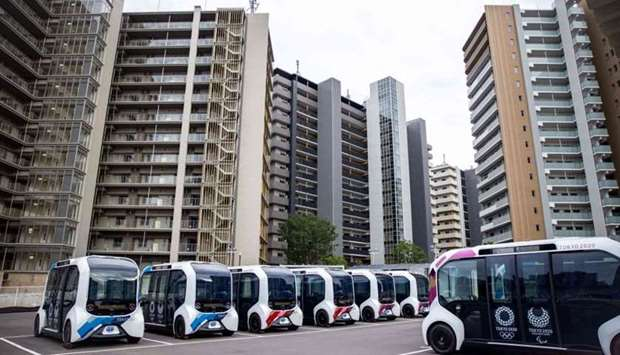 Autonomous electric vehicles, which will be used at the Olympic Village, are seen during a media tou