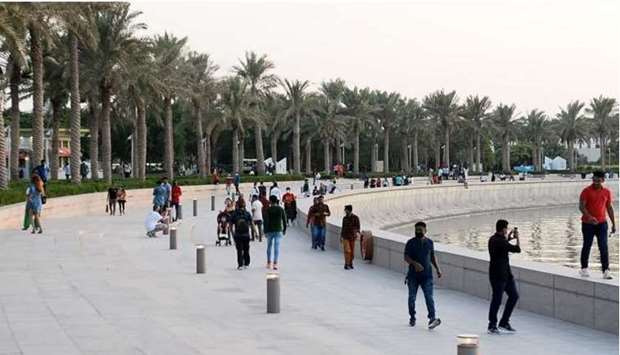 Residents seen following precautionary measures while celebrating Eid at MIA Park premises Tuesday.