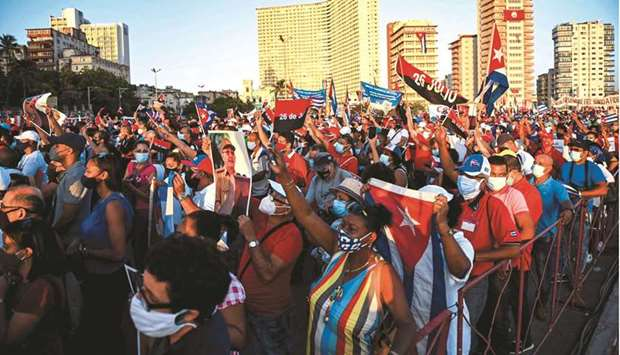 Cubans participate in an act of revolutionary reaffirmation to support the government of President M