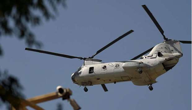 A US military helicopter flies towards the Green Zone in Kabul