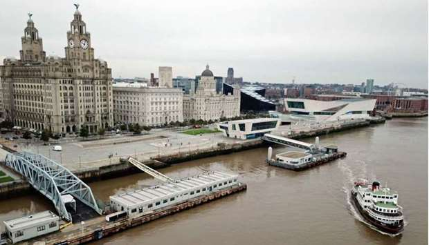 A Mersey Ferry pulling away from Pier Head, near the Liver Building, as it travels on the River Mers