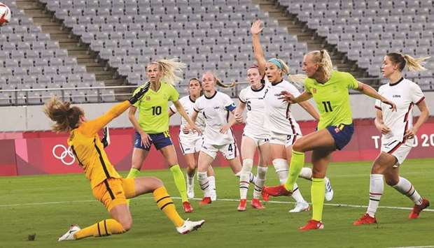 Sweden's Stina Blackstenius (second right) scores against USA during the women's Group G first round