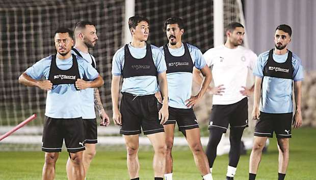 Al Sadd players train at the club's facility on Wednesday.