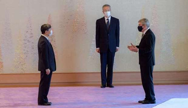 International Olympic Committee President Thomas Bach talks with Japan's Emperor Naruhito at the Imp