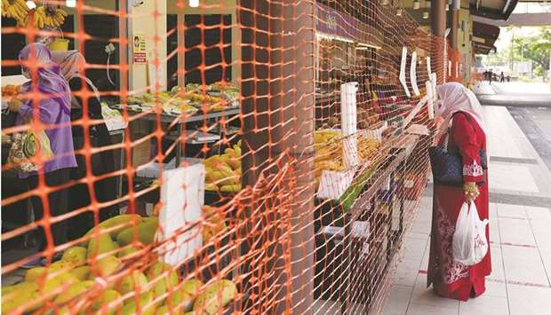 A wet market is cordoned off to limit entry and exit points in Singapore.
