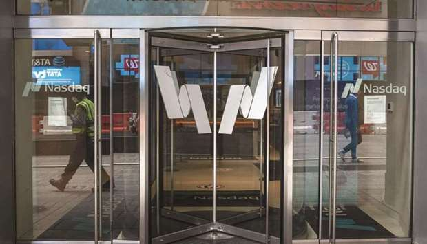 The Nasdaq logo is displayed on the doors at the Nasdaq MarketSite in New York. In the US, investors
