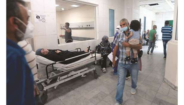 A patient rests on a bed in a hallway of the Rafik Hariri University Hospital (RHUH) in Lebanon's ca
