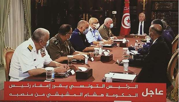 President Saied (second right) announces the dissolution of parliament and Prime Minister Mechichi's