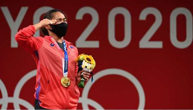 Gold medallist Philippines' Hidilyn Diaz stand on the podium.