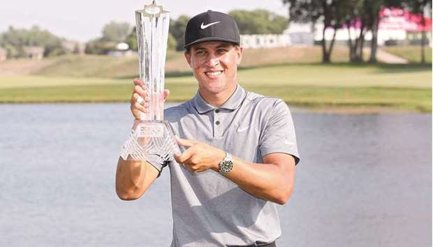 Cameron Champ poses with the trophy after winning the 3M Open at TPC Twin Cities in Blaine, Minnesot