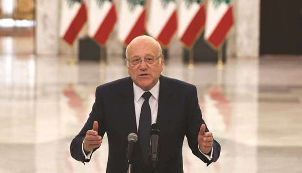 Lebanon's new Prime Minister-Designate Najib Mikati gestures as he talks at the presidential palace