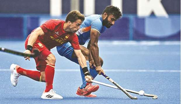 Spain's Marc Salles (left) and India's Surender Kumar vie for the ball during their Tokyo Olympic Ga